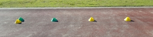 An image showing how to set up coloured cones to provide a visual cue for young athletes learning the triple jump.