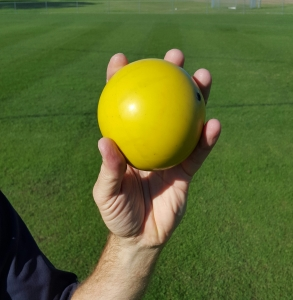 A photo that demonstrates how a shot being held in the hand can resemble a scoop of ice cream in a cone., which is a great analogy to use when teaching young athletes.