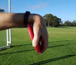Image showing discus incorrectly held in with wrist