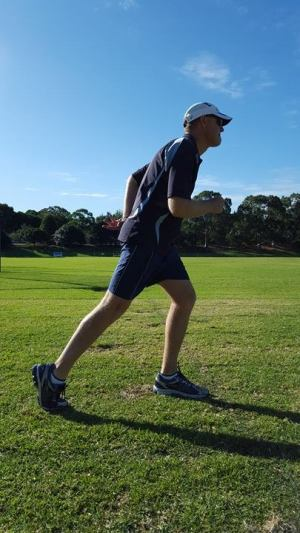 "Picture of an individual standing in the ""set"" position with a straight back leg"