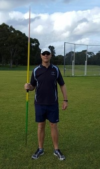 Javelin Thrower Standing Holding Javelin Point down - Front View