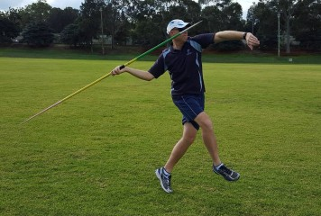 Javelin Thrower Jumping into the Final Stride - Side View