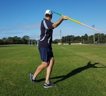 A javelin thrower incorrectly crossing the back foot behind the front foot