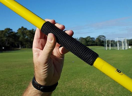 A javelin held incorrectly in the fingertips