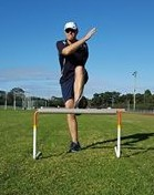 Hurdler incorrectly crossing their lead arm over their opposite shoulder