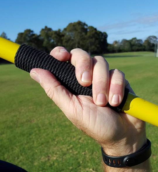 Javelin held incorrectly with no finger behind the binding