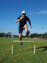 Hurdler incorrectly tucking their trail leg under their body