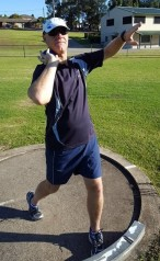 Shot putter with their elbow leading the shot,
