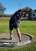 Shot putter tipping over to the side