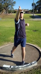 Shot putter twisting hand on release of the shot