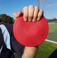 Discus held with fingers too far over the edge.