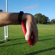 Discus incorrectly locked in by wrist.