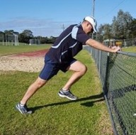 Acceleration Lean With Knee Drive Against Fence